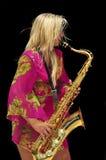 Blonde Girl Playing Saxophone Royalty Free Stock Images