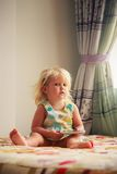 blonde girl plays with smartphone Royalty Free Stock Images