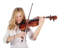Blonde girl plays on the violin Stock Photography
