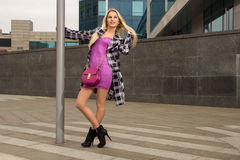 Blonde girl is posing in the city Royalty Free Stock Photo