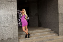 Blonde girl is posing in the city Stock Photography