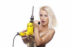 Blonde girl with a power drill Stock Photo