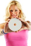 Blonde girl presenting white printable cd (ready for your logo) Royalty Free Stock Photos