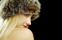 Blonde girl profile portrait in fur Stock Photography