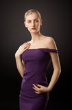 Blonde girl in purple dress Royalty Free Stock Photo