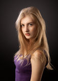 Blonde girl in purple dress Stock Photos