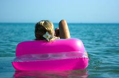 Blonde girl on raft Stock Image
