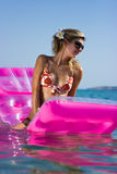 Blonde girl on raft Royalty Free Stock Images