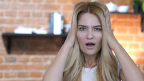 Blonde Girl Reacting To Failure, Mouth Opened, Hands on Head Royalty Free Stock Photos
