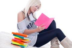 Blonde girl reading a book Stock Photos