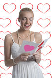 Blonde girl reads valentine postcard Stock Photo