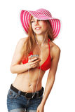 Blonde girl with red bikini top listening to music Royalty Free Stock Photos