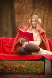 Blonde girl with red book. Stock Photo