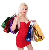 Blonde girl in red dress with shopping bags Royalty Free Stock Photography