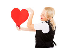 Blonde girl and red heart Royalty Free Stock Photos