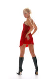 Blonde girl in red night-dress Royalty Free Stock Photography