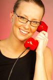 Blonde girl with red phone. Close up royalty free stock images