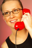 Blonde girl with red phone. Close up stock photography