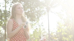 Blonde girl in a red polka-dot dress standing poses stock footage
