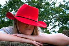 Blonde girl in red stetson hat Royalty Free Stock Photo
