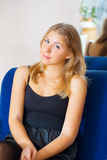 Blonde girl relaxing near mirror Stock Photography
