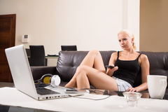 Blonde Girl with a remote control Stock Image