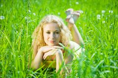 Blonde girl rests on  grass Royalty Free Stock Image