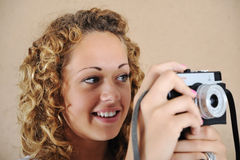 Blonde girl with camera Stock Photography