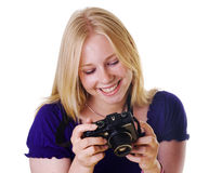 Blonde girl reviewing images on camera Stock Photos