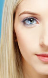 Blonde girl's half-face portrait Royalty Free Stock Photo
