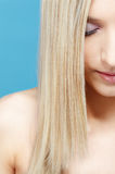 Blonde girl's half-face portrait Stock Photo