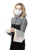 Blonde girl in sanitary medical mask against virus. Standing isolated over pure white background with encyclopedia Royalty Free Stock Photo