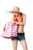 Blonde girl searching her bag. Isolated on white Stock Photography