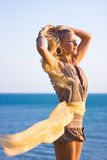 Blonde girl with shawl Stock Photos