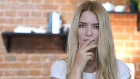 Blonde Girl in Shock with Loss Looking in Camera. High quality Royalty Free Stock Photography