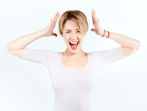 Blonde girl with shocked expression Stock Photo
