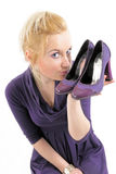 Blonde girl with shoes. Blue eyes blonde girl with shoes in the hand Stock Photos