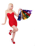 Blonde girl with shopping bags Stock Images