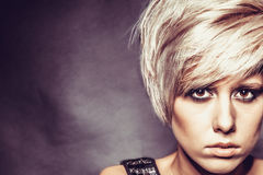 Blonde girl with a short stylish haircut Royalty Free Stock Photo