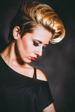 Blonde girl with a short stylish haircut Stock Images