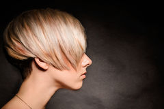 Blonde girl with a short stylish haircut Royalty Free Stock Images