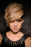 Blonde girl with a short stylish haircut Royalty Free Stock Image