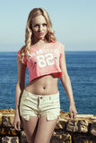 Blonde girl with shorts Royalty Free Stock Image