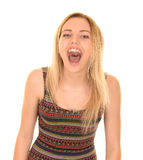 Blonde girl shouting. Teenage blonde girl with long hair wearing print dress with mouth open shouting Stock Photography