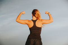 Blonde girl showing body strength. Stock Photography