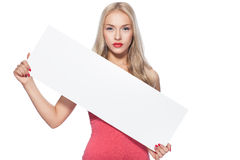 Blonde girl shows poster. On plokate can do advertising inscription royalty free stock photos