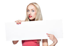 Blonde girl shows poster. stock photos