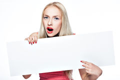Blonde girl shows poster. Stock Photos