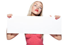 Blonde girl shows poster. Stock Photography