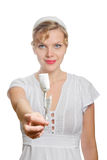 Blonde girl with a single white paper rose Royalty Free Stock Photo